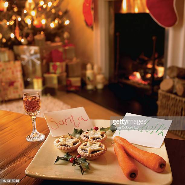Mince Pie, Carrots and a Glass of Sherry in a Living Room in Anticipation of Father Christmas