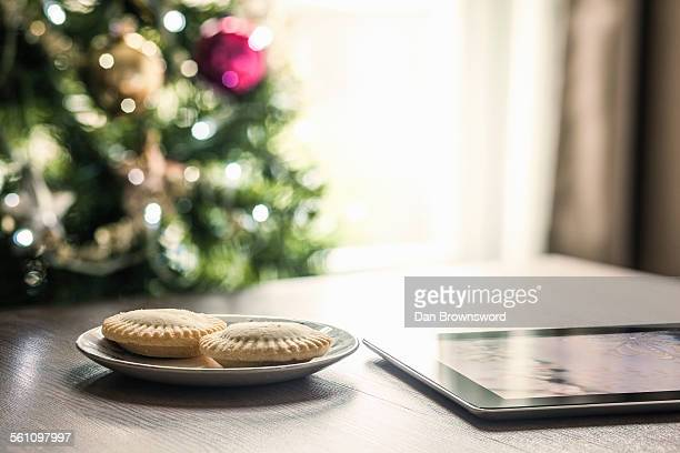 Mince pies and digital tablet on table