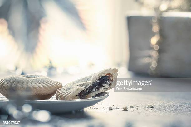 Mince pies with missing bite on plate