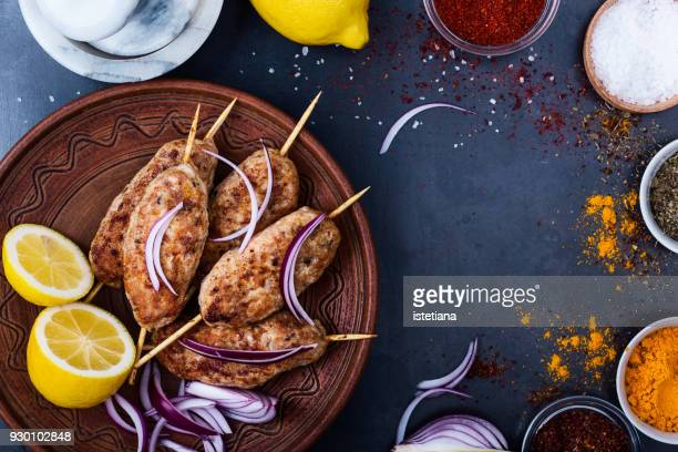 Minced chicken meat kebab on ceramic plate, healthy meal