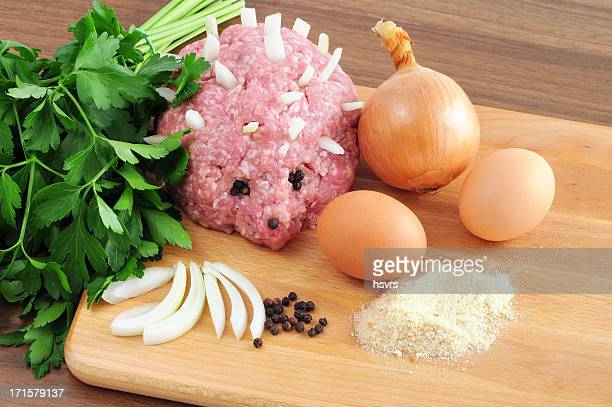 minced ground meat in hedgehog form onions pepper parsley eggs - ground beef stock pictures, royalty-free photos & images