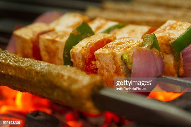 Minced meat and cottage cheese kabab being barbecued