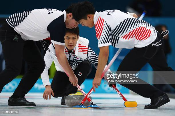 MinChan Kim of South Korea competes in the Curling Men's Round Robin Session 4 held at Gangneung Curling Centre on February 16 2018 in Gangneung...