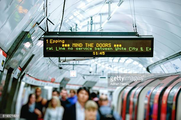 Mind the doors warning sing on display above commuters
