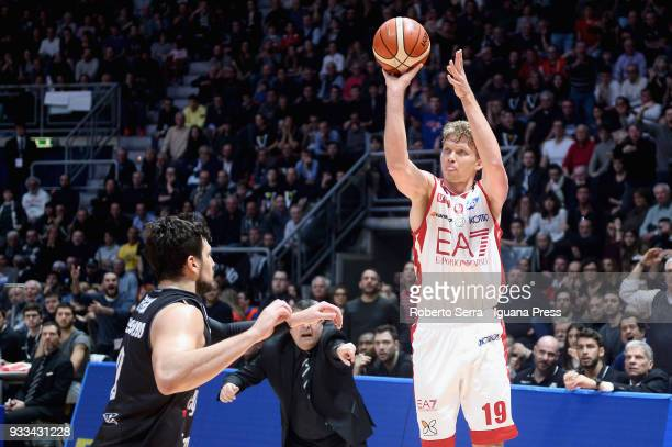 Mindaugas Kuzminskas of EA7 competes with Alessandro Gentile of Segafredo during the LBA LegaBasket of Serie A match between Virtus Segafredo Bologna...