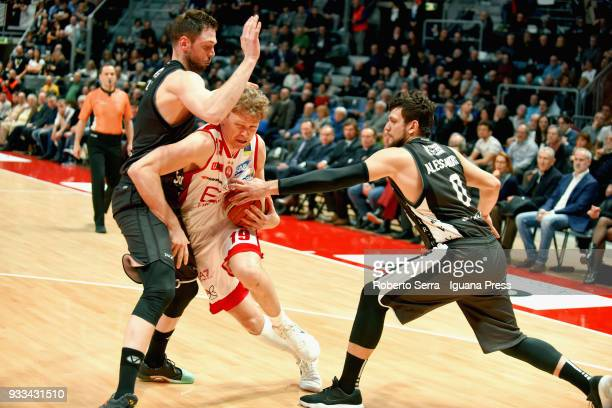 Mindaugas Kuzminskas of EA7 competes with Filippo Baldi Rossi and Alessandro Gentile of Segafredo during the LBA LegaBasket of Serie A match between...