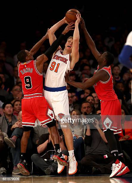 Mindaugas Kuzminskas of the New York Knicks tries to pass as Rajon Rondo and Jerian Grant of the Chicago Bulls defend at Madison Square Garden on...