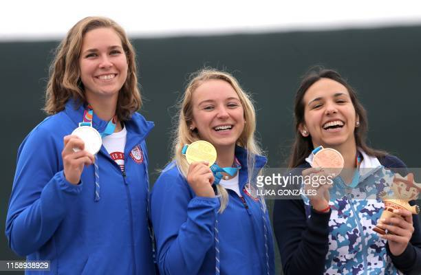 US Minden Miles US Alison Weisz and Argentina's Fernanda Russo pose on the podium with their silver gold and bronze medals respectively after...