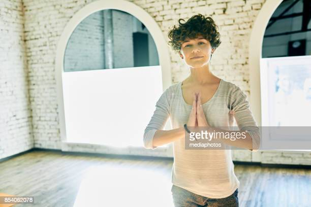mindfulness as result of yoga practice - yoga teacher stock pictures, royalty-free photos & images