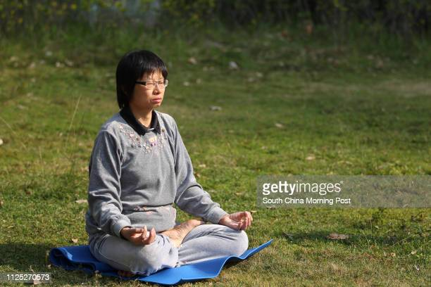 Mindfulness enthusiast Brenda Tsang Kwailing demonstrates meditation in Ma On Shan 18DEC11