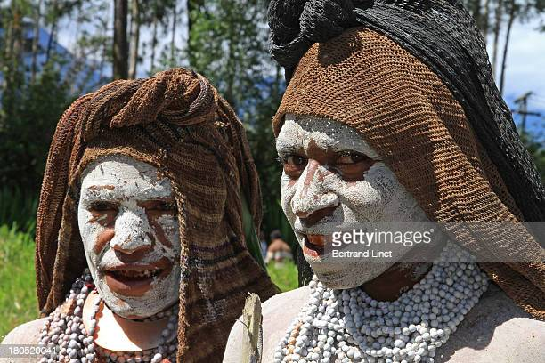 Mindima widows wearing necklaces of seeds .The woman will remove one collar of seeds each day while the mourning time until the last one.Then she can...