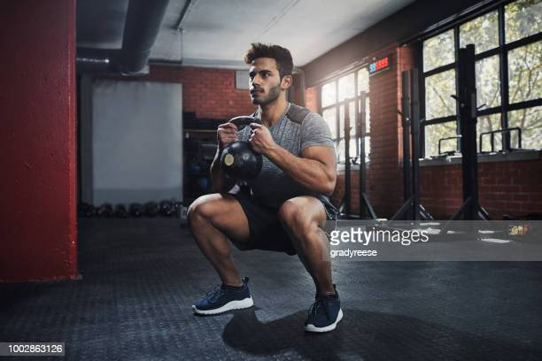 mindset is everything - squatting position stock pictures, royalty-free photos & images
