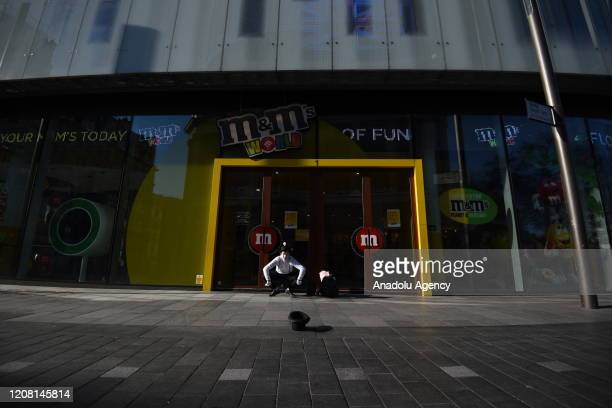 A mine Artist in an empty Leicester Square on March 24 2020 in London England British Prime Minister Boris Johnson announced strict lockdown measures...