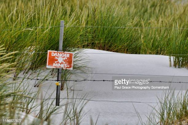 mine field notices yorke bay, east falkland. - land mine stock pictures, royalty-free photos & images