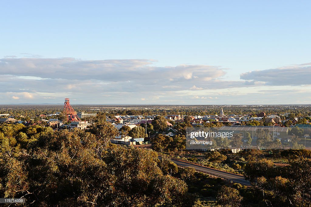A mine headframe, left, stands in Kalgoorlie, Australia, on Tuesday, Aug. 6, 2013. Kalgoorlie, a town in the Goldfields-Esperance region of Western Australia, is home to the annual Diggers & Dealers mining forum. Photographer: Carla Gottgens/Bloomberg via Getty Images