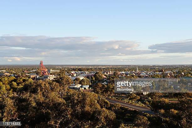 A mine headframe left stands in Kalgoorlie Australia on Tuesday Aug 6 2013 Kalgoorlie a town in the GoldfieldsEsperance region of Western Australia...