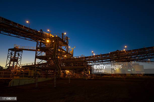 mine processing infrastructure at sunrise - coal mining stock photos and pictures