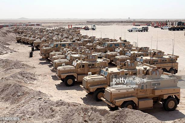mine resistant ambush protected vehicles at camp taqaddum, iraq. - mine resistant ambush protected stock pictures, royalty-free photos & images