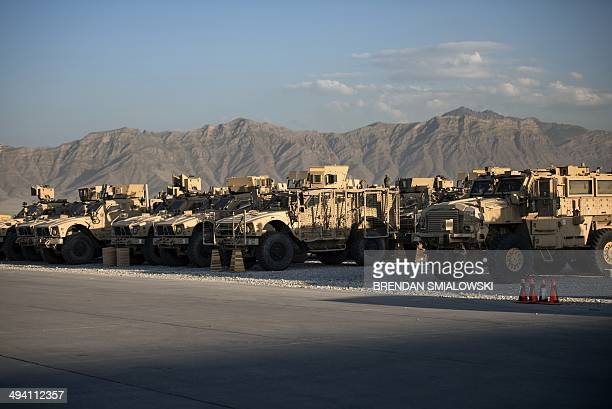 Mine resistant armored vehicles and other machinery waiting to be transported out of Afghanistan are seen on the flight line at Bagram Airfield in...