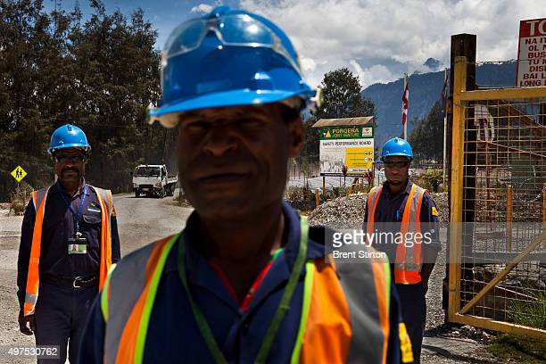 Mine security seen next to the $30 million dollar security fence of the Porgera Joint Venture Mine Papua New Guinea 23 November 2010 The fence has...