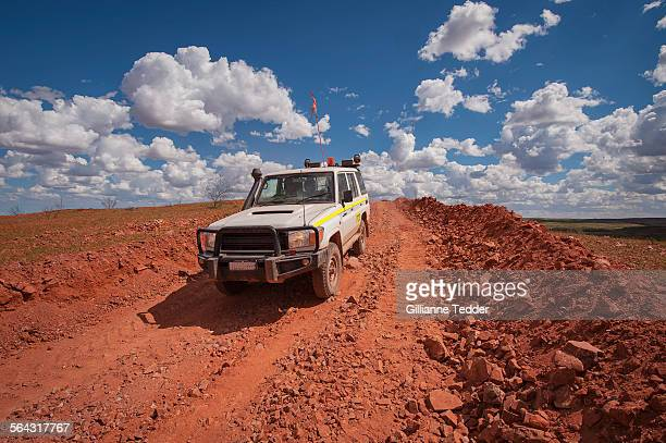 Mine vehicle in outback on rough road