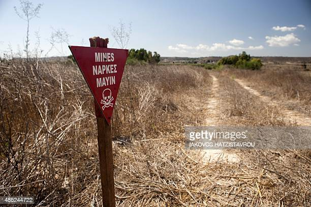 A mine warning sign sign is pictured during a demonstration of demining methods by UNIFIL's Cambodian mine experts on August 26 2015 in the...