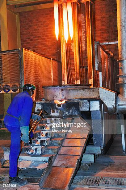 mine worker pouring gold - golden goggles stock pictures, royalty-free photos & images