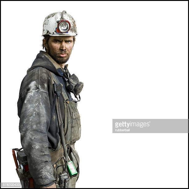 mine worker with flashlight helmet - coal miner stock photos and pictures