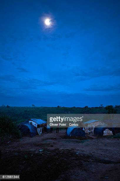 Mine workers are pictured around their tents in this camp for a short night's rest outside the village near Angola's border with Congo on 28 March...