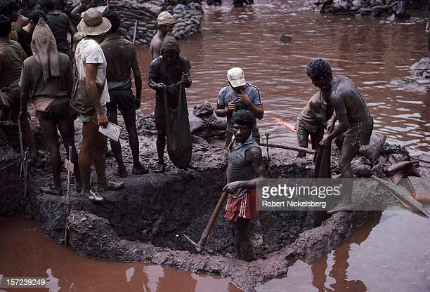 Mine workers or garimpeiros dig ore from a plot July 15 1985 at the bottom of the Serra Pelada Brazil gold mine Each plot owner had a claim of 66...