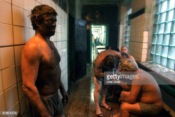 Mine workers smoke cigarettes whilst waiting for a shower after a days work in the pit on December 3 2004 in Donetsk UkraineThe miners receive $250...