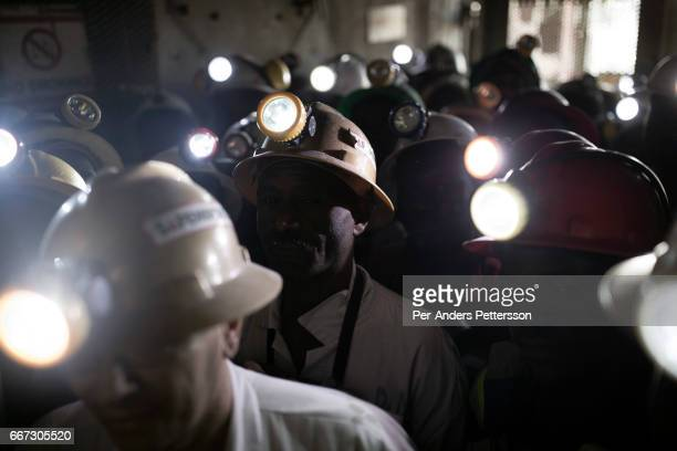 Mine workers wait to descend underground for an 8hour shift mining copper in one of the shafts at Mopani on July 6 2016 Glencore an AngloSwiss...