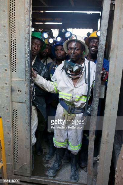 Mine workers wait to descend underground for an 8hour shift mining copper in one of the shafts at Mopani copper mine on July 6 2016 in Mufulira...