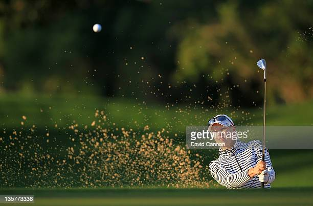 Minea Blomqvist of Finland plays her third shot at the par 4 1st hole during the first round of the 2011 Omega Dubai Ladies Masters on the Majilis...
