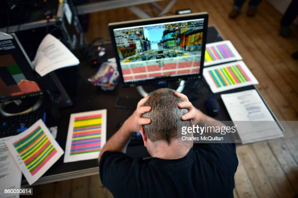 Minecraft artist Dragnoz holds his head in his hands in frustration during a 'Playcraft' live rehearsal at The Playhouse Theatre and Arts Centre on...