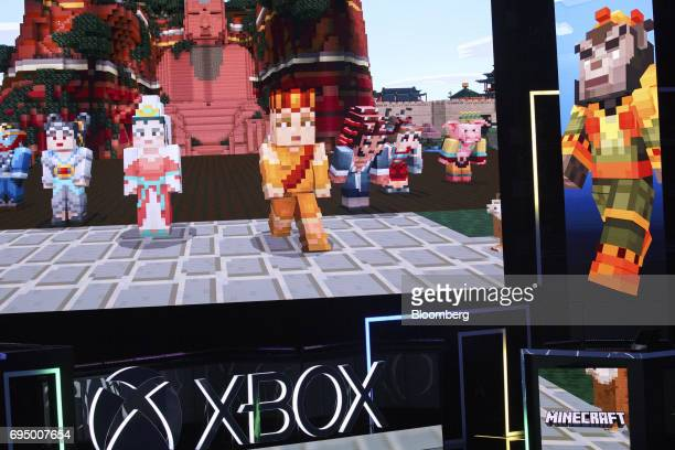 Minecraft characters are displayed on screens during the Microsoft Corp Xbox One X reveal event ahead of the E3 Electronic Entertainment Expo in Los...