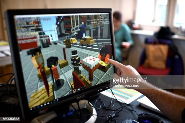 Minecraft digital artist points at the digital version of the character 'Sal' as they work backstage during a 'Playcraft' live rehearsal at The...