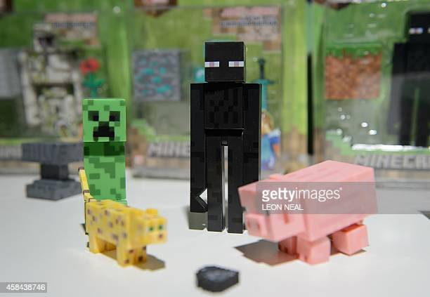 Minecraft figures are disaplyed at the DreamToys toy fair in central London on November 5 2014 The event sees manufacturers of the predicted...