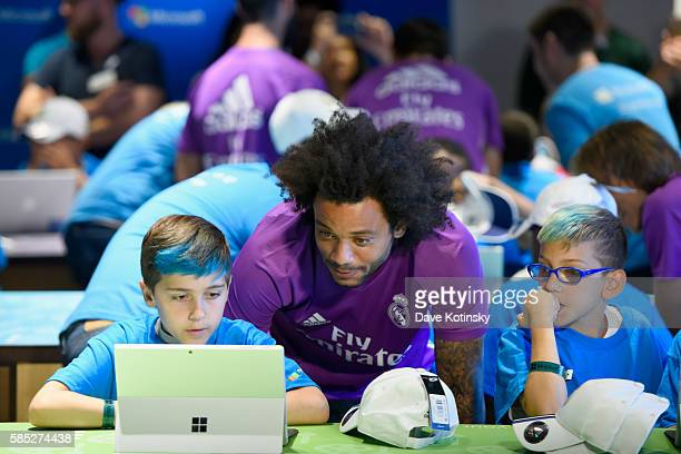 Minecraft Hour of Code participants show coding project to Real Madrid CF player Marcelo Vieira da Silva Junior at the Microsoft Store on August 2...