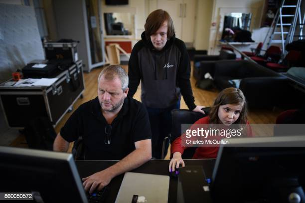 Minecraft map maker Dragnoz and Django Bennett Clarke work backstage during a 'Playcraft' live rehearsal at The Playhouse Theatre and Arts Centre on...