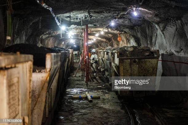 Mined platinum rich rock sits inside a freight wagon in the mine shaft during a media tour of the SibanyeStillwater Khuseleka platinum mine operated...
