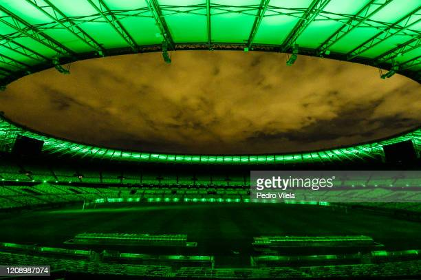 Mineirao Stadium is lit up in green the color of hope as a token of appreciation to all the professionals involved in the effort to minimize the...