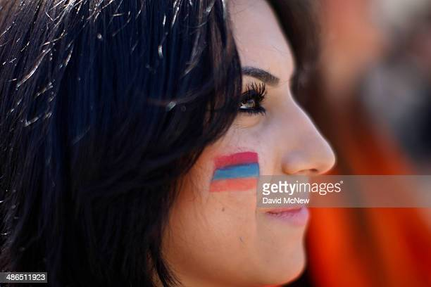 Mineli Hovsepian wears face paint in the colors of the Armenian flag while participating in a march on the 99th anniversary of the Armenian Genocide...