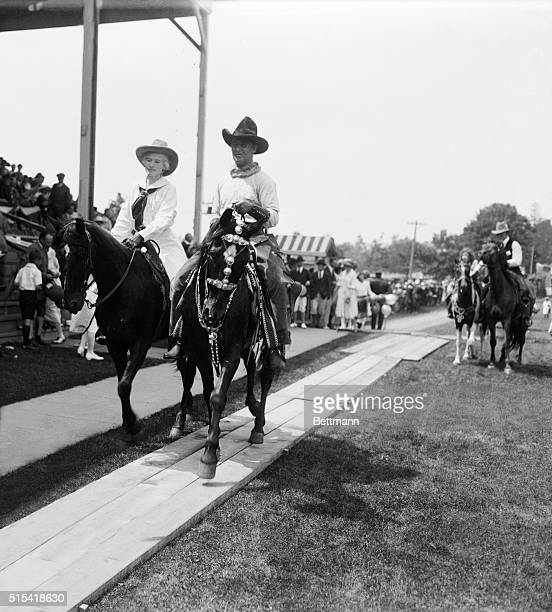 Wild West Circus for Society Folks Annie Oakley and Fred stone riding before the Grand Stand