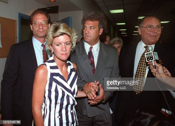 Attorney Ed Shulman Mary Jo Buttafuoco and Joey Buttafuoco and his attorney Marvyn Kornberg leave court during lunch recess on July 20 1993 in...