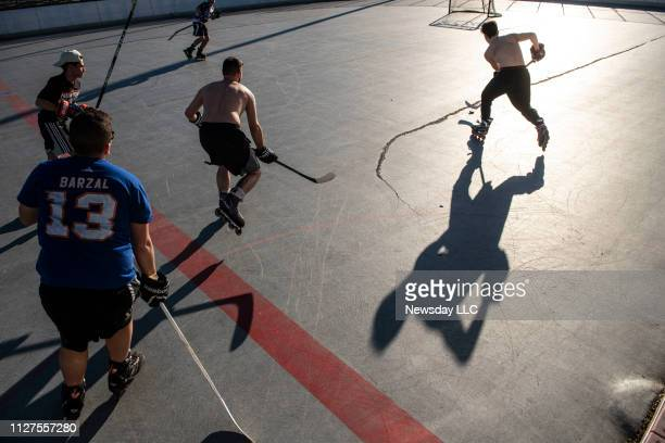 Friends play roller hockey at Wilson Park in Mineola New York on a mild winter day on February 4 2019