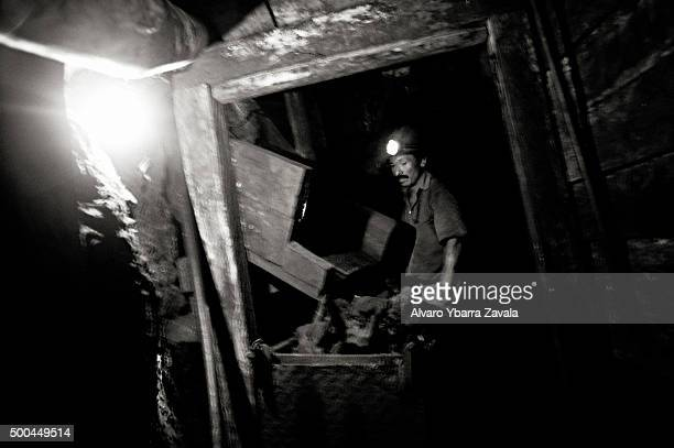 A miner at work inside the Millionaire mine The miners work simply for food spending 12 hours underground each day with virtually no safety...