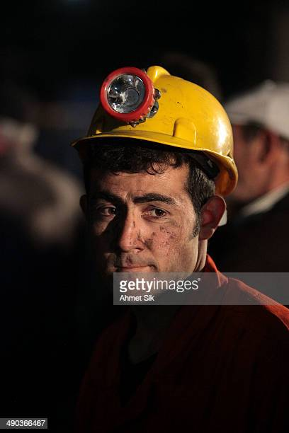 Miner awaits trapped friends on May 14, 2014 in Soma, Turkey. Rescuers pulled more dead and injured from the coal mine in western Turkey on Wednesday...
