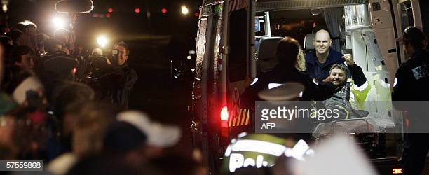 Miner Brant Webb waves from the back of an ambulance after spending two weeks trapped in the Beaconsfield Gold Mine at Beaconsfield 09 May 2006 Webb...