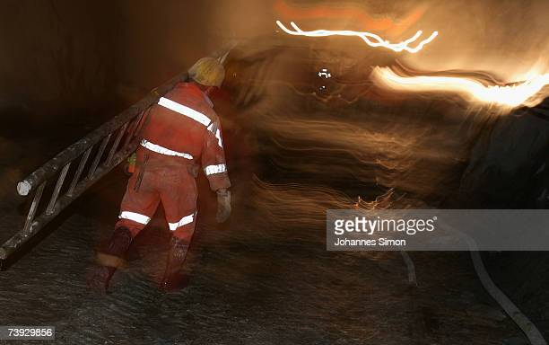 A miner carries a ladder at the construction site for the Gotthard Base Tunnel on April 19 2007 near Sedrun Switzerland Deep beneath the Alps the...